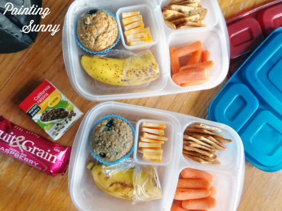 School Lunch Round-Up: blueberry oatmeal muffins,  colby jack cheese cubes, a banana half, Kashi 7 Grain crisps, and baby-cut carrots | Painting Sunny