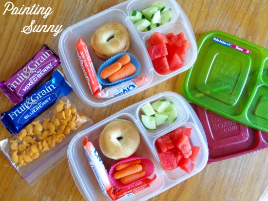 School Lunch Round-Up: mini-bagel with butter and strawberry jam, baby-cut carrots, Chobani yogurt tube, watermelon chunks, and cucumber chunks | Painting Sunny