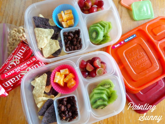 School Lunch Round-Up: mix of white and blue tortilla chips, seasoned black beans, colby jack cheese cubes, kiwi slices, and red grapes halved | Painting Sunny