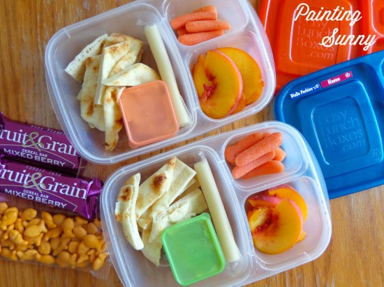 School Lunch Round-Up: slices of naan bread, hummus (in container), string cheese, sliced peach, and baby-cut carrots | Painting Sunny